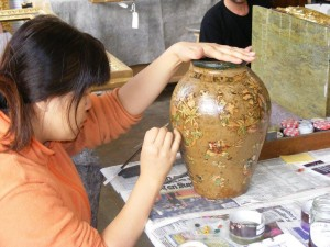 8 The restoration of a stoneware vase with decoupage decoration